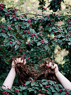 Woman hiding in berry bush  - p1229m1221107 by noa-mar