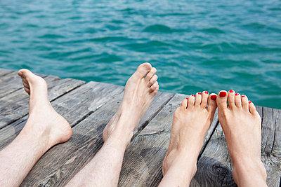 Feet on a boardwalk - p4410489 by Maria Dorner