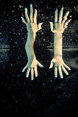 Hands underwater - p1019m1461895 by Stephen Carroll