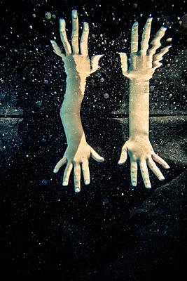 Hands underwater - p1019m1461895 by Stephen Carroll