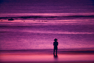 Person on beach at sunset - p1395m1465998 by Tony Arruza