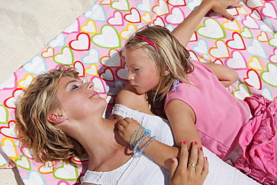 Mother and daughter relaxing in the sunshine - p045m907343 by Jasmin Sander