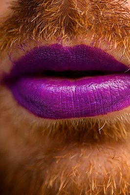 Bearded man with lipstick  - p1628m2288913 by Lorraine Fitch