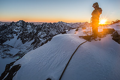 Climber standing on peak after finishing climbing route at sunset, Mieguszowiecki Szczyt Wielki, Tatra Mountains, Malopolskie Voivodeship, Poland - p343m2032578 by Cavan Images