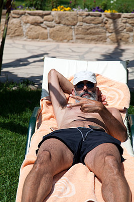 Man on Lounger - p1248m1169573 by miguel sobreira