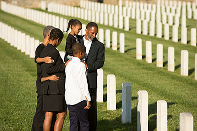 Multi-generation Black family at military cemetery - p555m1305131 by WHL