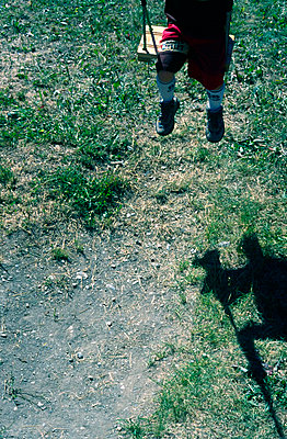 Part of a boy having a swing and his shadow - p7780049 by Denis Dalmasso