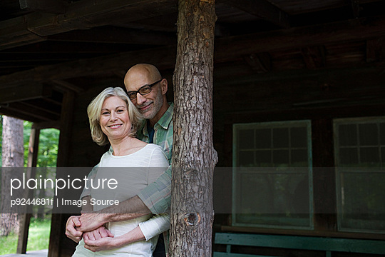 Mature couple at rural retreat - p9244681f by Image Source