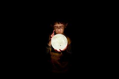 Small Young Boy Looking Into a 3D Moon Lamp - p1166m2095512 by Cavan Images