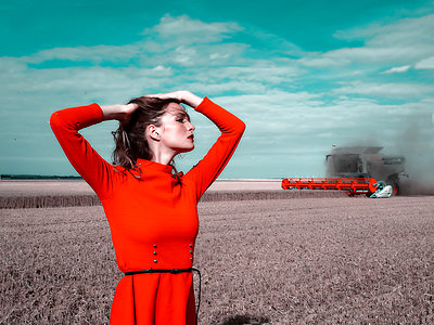 Woman in red dress on a field - p1413m2219828 by Pupa Neumann