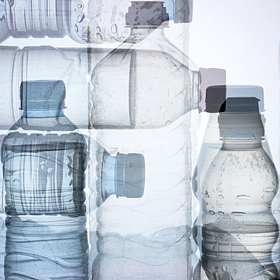 Used water bottles and white background - p1166m2106090 by Cavan Images