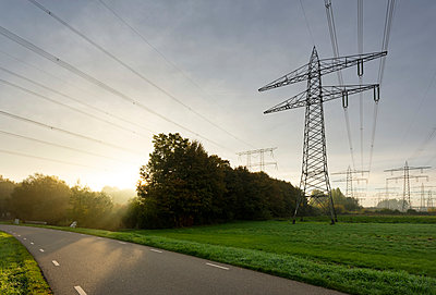 Power lines near coal fired power station, Netherlands - p429m2058259 by Mischa Keijser