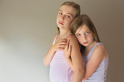 Serious Caucasian girls hugging - p555m1409045 by Shestock