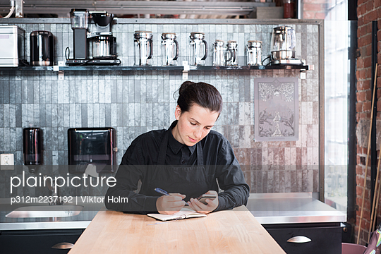 Woman in cafe - p312m2237192 by Viktor Holm