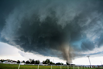 A tornado rated EF4 - with winds 166 to 175 miles per hour - striking a neighbourhood in Katie, Oklahoma - p429m1181024 by Chris Kridler