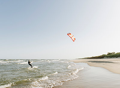 Kiteboarder riding the waves - p300m2118666 by Hernandez and Sorokina