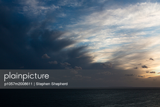 Thunderclouds over the sea at sunset - p1057m2008611 by Stephen Shepherd
