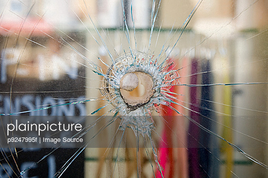 Smashed window - p9247995f by Image Source