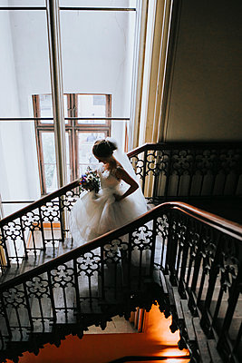 Bride in the staircase - p680m2176341 by Stella Mai