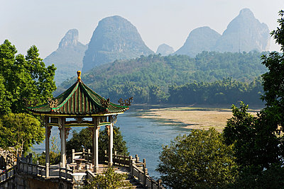 Temple and li river in yangshuo - p9246160f by Image Source