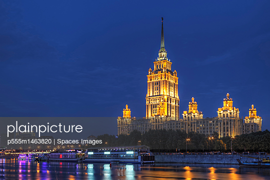 Ornate buildings illuminated at night, Moscow, Russia