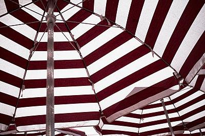 Striped umbrellas - p301m960780f by Michael Mann