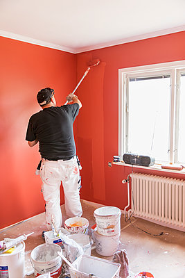 Sweden, Mature man painting wall - p352m1078827f by Ester Sorri