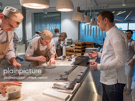 Chefs in the kitchen - p390m2109321 by Frank Herfort