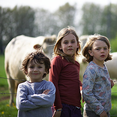 Three kids in the country - p1430m1503589 by Charlotte Bresson
