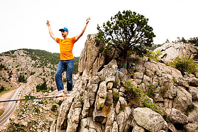 A male highliner walks the Elephant Buttresses highline in Boulder Canyon - p343m801177f by Kyle Sparks