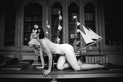 Women in vintage lingerie on a table - p1521m2215026 by Charlotte Zobel