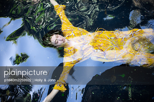Woman in yellow dress in the lake - p1640m2259922 by Holly & John