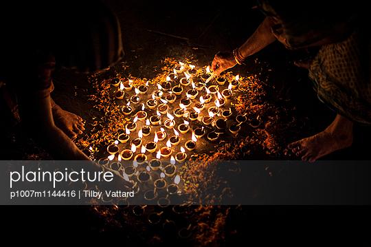 Candle light around Diwali rangoli - p1007m1144416 by Tilby Vattard