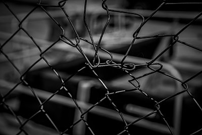 Bent section of chain-link fence. - p1072m1348962 by Peter Glass