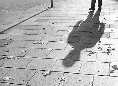 Shadow of a person on pavement - p4902782 by Jan Mammey