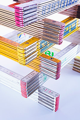 Stack of folding rules - p1149m2031043 by Yvonne Röder