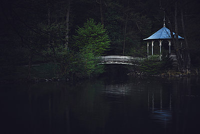 Pavillion with bridge in the darkness - p1312m2216067 by Axel Killian