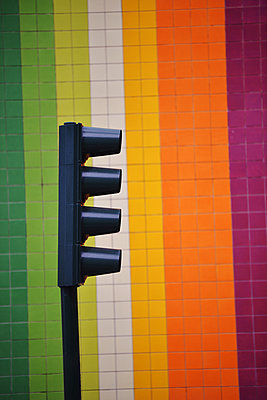 Traffic light against wall with colourful tiles - p1695m2290934 by Dusica Paripovic