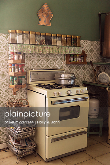 Vintage stove in old-fashioned kitchen - p1640m2261144 by Holly & John