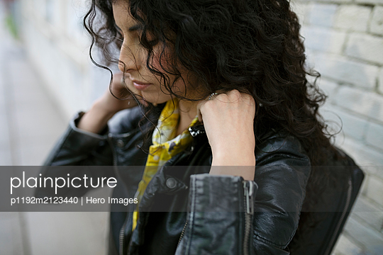 Woman in leather jacket with backpack - p1192m2123440 by Hero Images