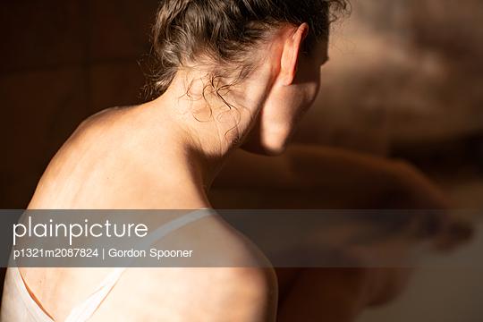 Woman wearing underskirt - p1321m2087824 by Gordon Spooner