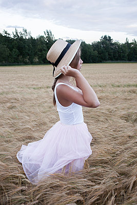 Girl on rye field - p312m1470671 by Christina Strehlow