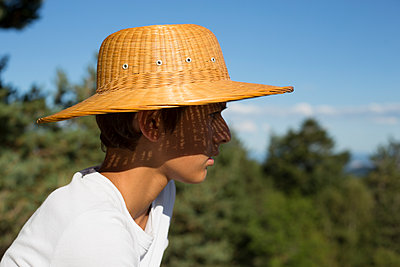 Boy with a straw hat - p445m1177050 by Marie Docher