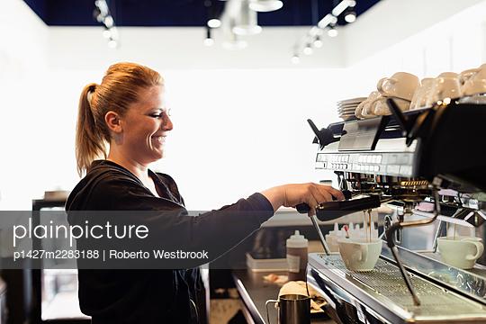 Coffee shop barista making coffee - p1427m2283188 by Roberto Westbrook