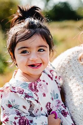 Smiling girl looking at camera - p312m2249756 by Anna Johnsson