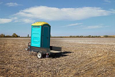 Portable toilet in field - p9241840 by Benjamin Rondel