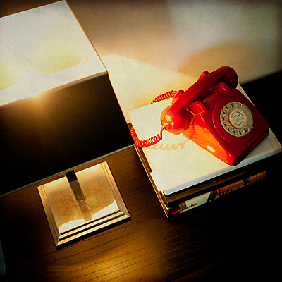 Old red telephone - p1072m829129 by Kevin Mallia
