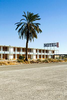 An abandoned motel, Salton City, California - p1094m890276 by Patrick Strattner