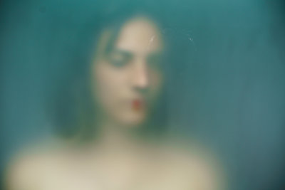 Female face, blurred view - p1321m2278388 by Gordon Spooner
