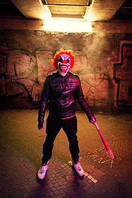 Evil clown under a bridge - p1515m2093198 by Daniel K.B. Schmidt